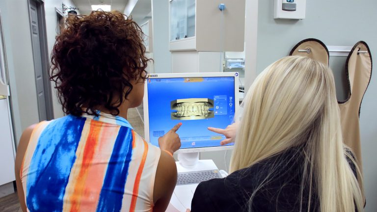 Patient and Hygienist viewing 3D scan