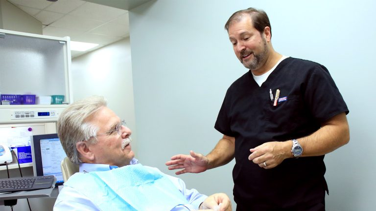 Patient discussing restorative dentistry with Dr. Henderson