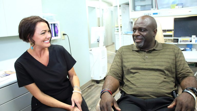 Team member laughing with patient